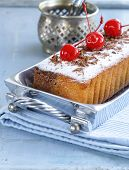 foto of pound cake  - pound cake with powdered sugar and berries - JPG
