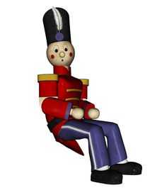 stock photo of tchaikovsky  - Toy soldier in red uniform sitting and waiting - JPG