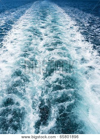 White Wake On The Blue Ocean