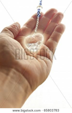 Hand holding crystal heart