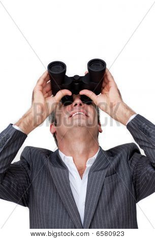Positive Businessman Looking Up Through A Pair Of Binoculars