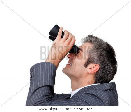 Businessman Looking Up Through A Pair Of Binoculars