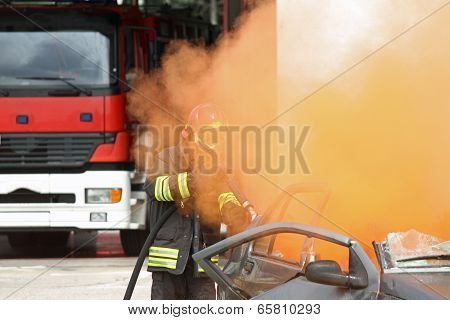 Firefighter Uses A Hydrant Toward A Car