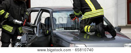 Firefighters While They Open The Car After The Accident