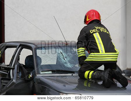 Italian Fireman While Breaks The Glass Windshield Broken Car