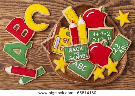 Back to school cookies on a wooden background