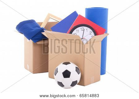 Moving Day Concept - Cardboard Boxes With Stuff Isolated On White