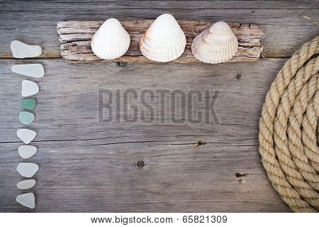 Marine background - seashells, rope and sea glasses