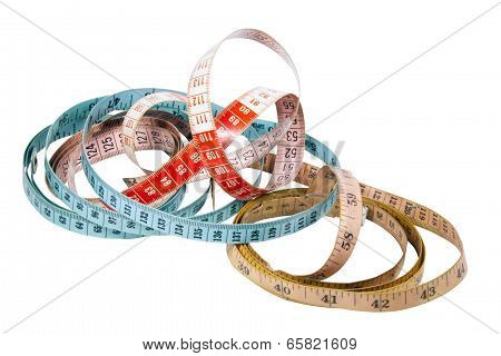 Three Tape Measures Marked In Inches And Centimetres