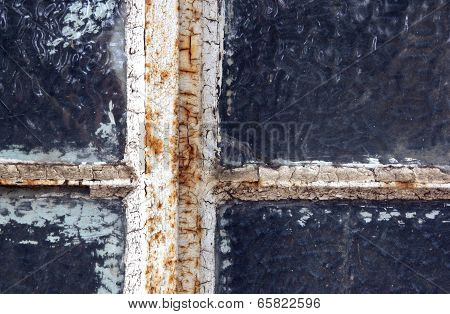 Rusted Neglected Window Frame With Flaking Putty