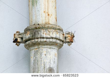 Rusted Clamped Join In Metal Sewerage Pipe