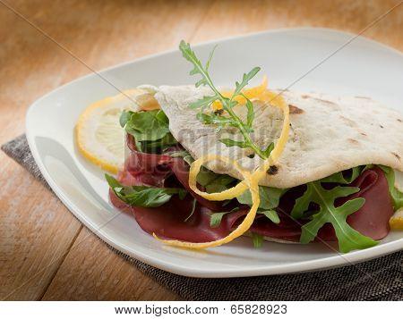 chapati sandwich  with bresaola and arugula salad
