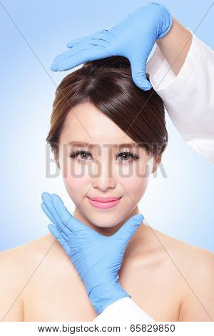 Female face with plastic surgery glove