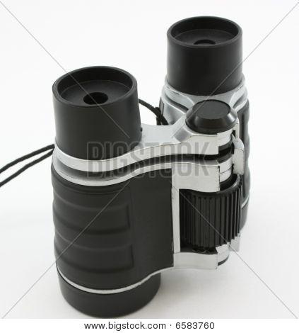 Black modern binoculars, standing