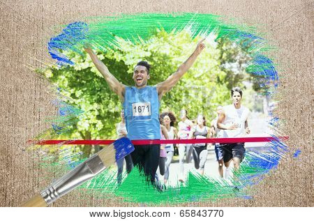 Composite image of racer crossing finishing line with paintbrush dipped in blue against weathered surface