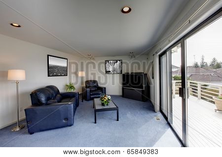 Living Room With Walkout Deck