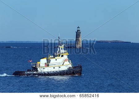 Portland, Maine - Tug boat passing in front of Ram Island Ledge Light