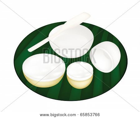Thai Dessert Of Coconut Custard On Green Banana Leaf