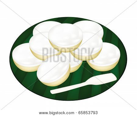 Pile Of Coconut Puddings On Banana Leaf
