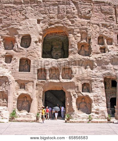 Tourist Entering One Of The Caves In The Yungang Grottoes, China