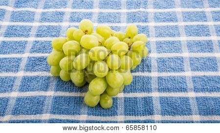 Green Grapes On Blue Towel