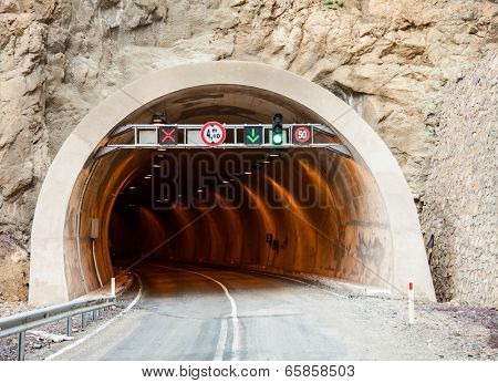 Entrance to a road tunnel with traffic signs