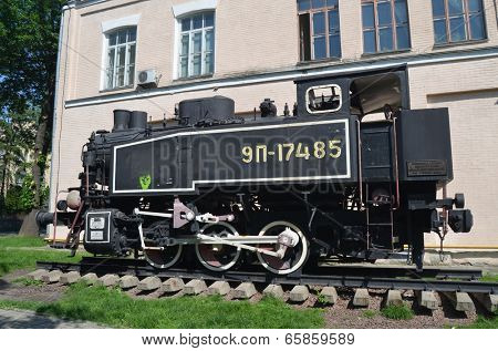 KIEV, UKRAINE - 26 MAY, 2014: The monument of Soviet steam locomotive near technical laboratories of National Polytechnic University on May 26, 2014 in Kiev, Ukraine