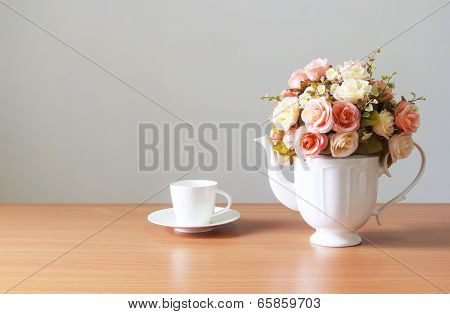 Romantic  A Bouquet Of Roses In White  Jug With Coffee Cup On Wooden Table  And Gray Concrete Walls