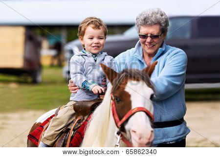 First Pony Ride For A Little Boy