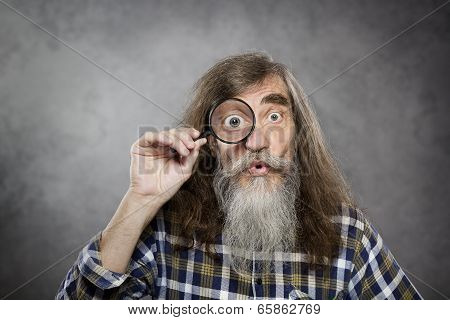 Senior Old Man Looking Through Zoom Magnifying Glass. Funny Elder Amazement Investigation Or Test Vi