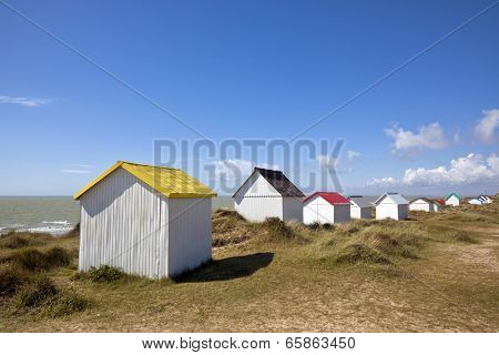 Beach cabins in the dunes of Gouville-Sur-Mer at the western coast of Cotentin peninsula, Manche region, Basse-Normandie