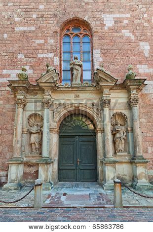 Left Portal (1692) Of St. Peter Church In Riga, Latvia