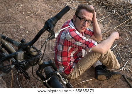 A Tired Man With A Broken Bike In Reverie