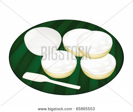 Thai Dessert Of Coconut Custard On Banana Leaf