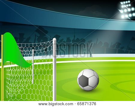 Creative poster, banner or flyer design with colorful soccer ball in front of goal post in night background.