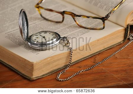 Vintage Pocket Watch Glasses  And Open Old Book
