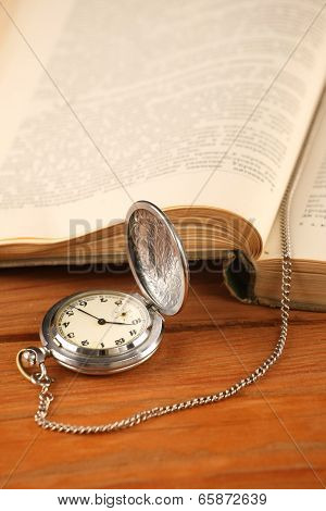 Vintage Pocket Watch And Open Old Book