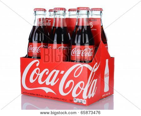 A 6Pk Of Coca-cola Bottles