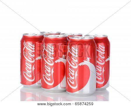 Six Cans Of Coca-cola