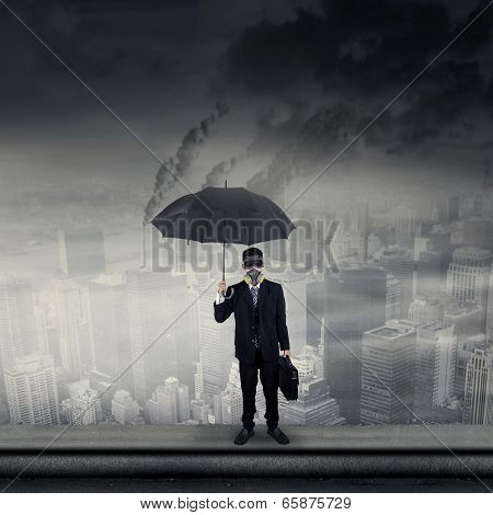 Businessman On Rooftop Wearing Gas Mask