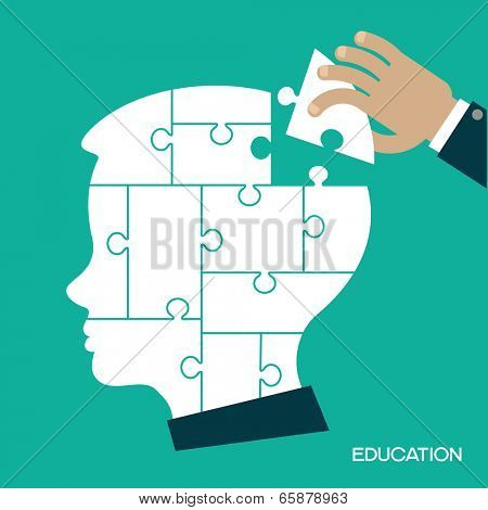 Puzzles in the form of a man's head. Human hand inserts the missing puzzle in his head. Concept of education. Complete The Person