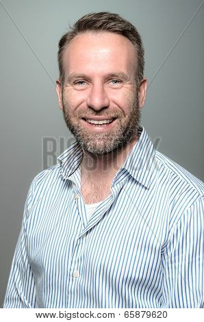 Portrait Of A Smiling Happy Handsome Man