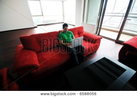 Happy Couple In Empty Apartment