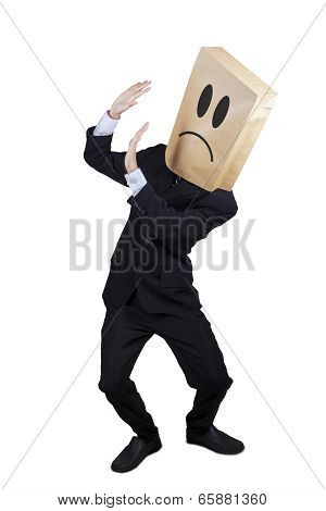 Scared Businessman Keeping His Face