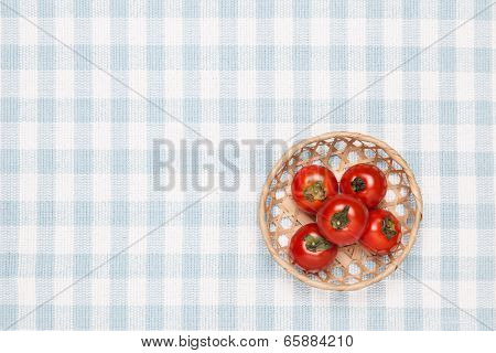 Tomatoes On The Table And Put It In A Basket