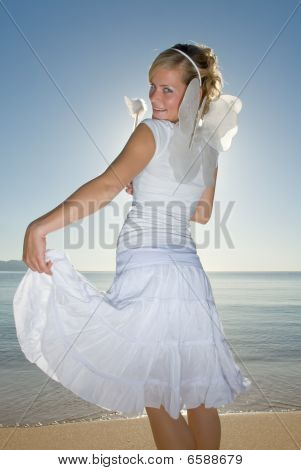Girl In White Dress On A Beach