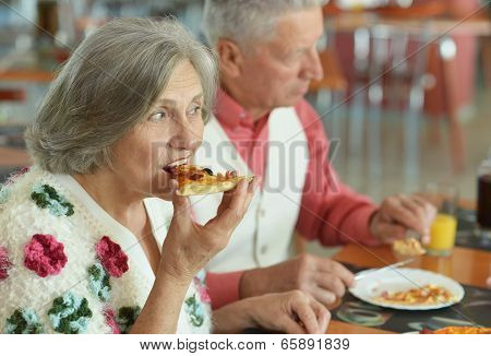 Elder couple eating