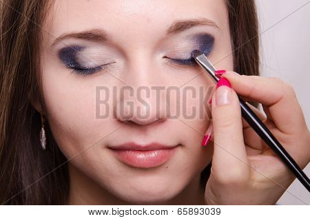 Drawing Bright Shadows On Girl's Eyelids With Makeup