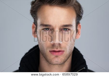 Fashion man face close up over gray background