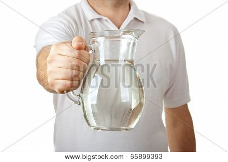 Male In White Shirt Giving Jug Of Water
